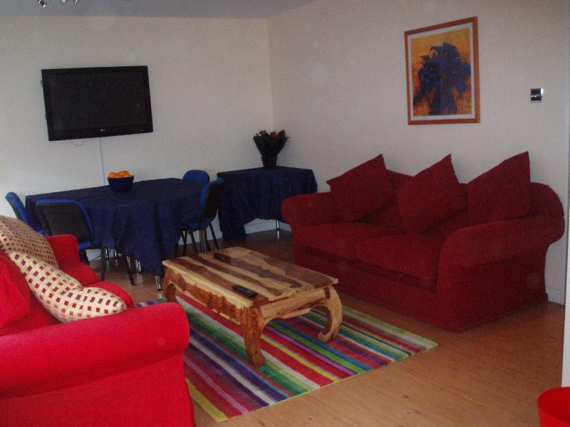 Sitting and dining area (42 inch plasma screen). Large double sprung sofa bed.