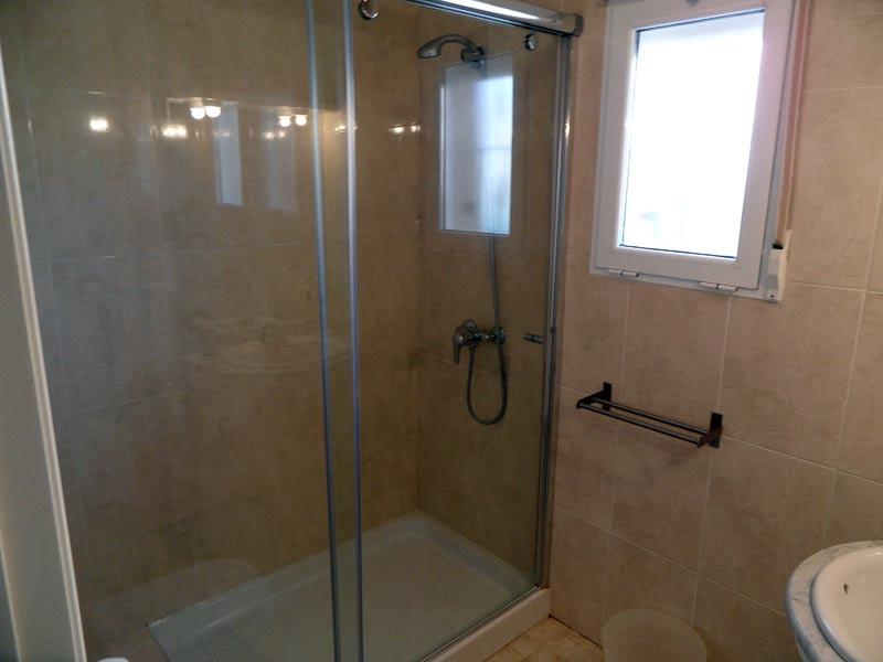 Seperate family bathroom with large walk in shower