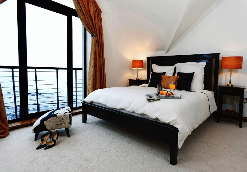 Master Bedroom; California King bed(6'*7*); Juliet balcony with Atlantic views