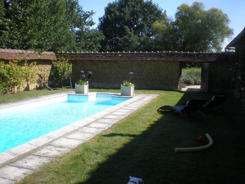 Swimming pool adjacent to guest cottage