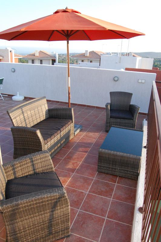 Relax on the roof terrace overlooking the pool