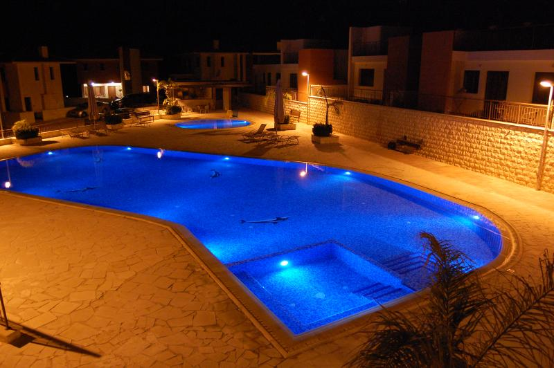 Night view of pools from the roof terrace