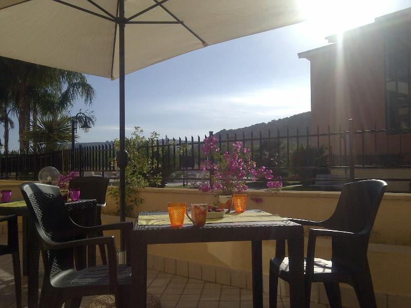 Enjoy a sunny breakfast outside on the large patio over looking the pool