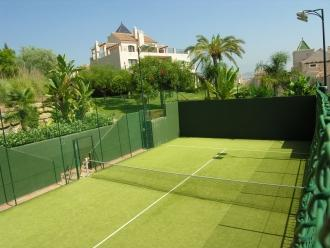 Spanish tennis courts are free to use on site just beyond the pool.