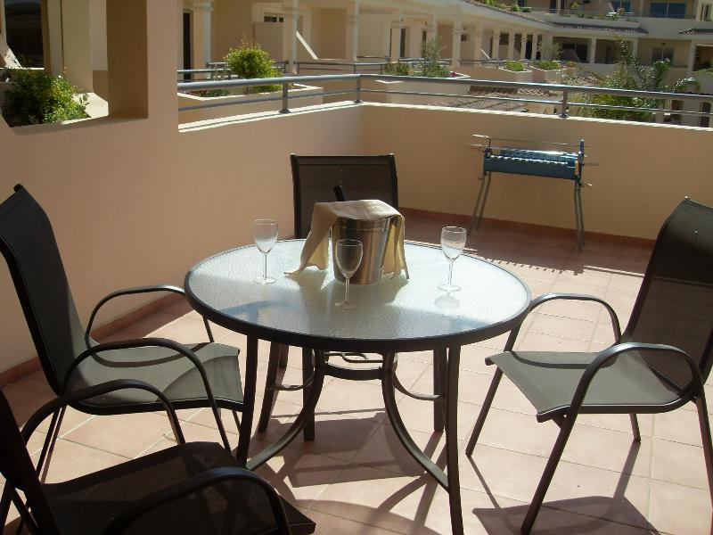Outdoor dining on the spacious balcony