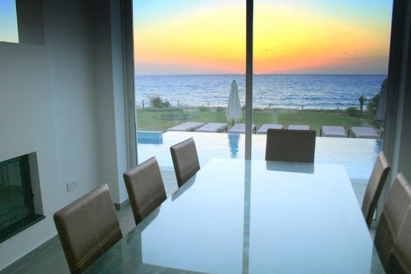 Sunset view and pool view from indoor dinning table