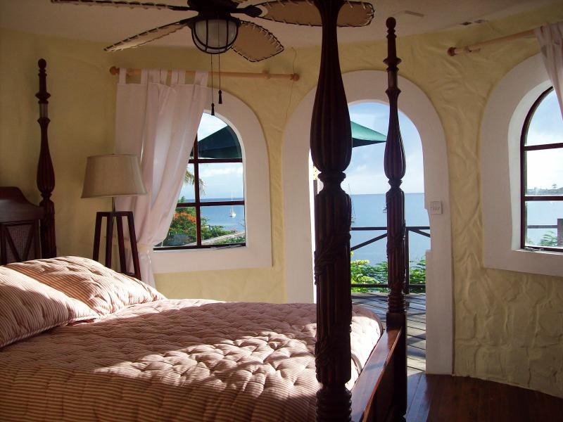The very romantic master bedroom, a round room with four-poster bed