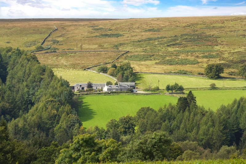 Middleholms with a large garden, set in farmland and open moorland.