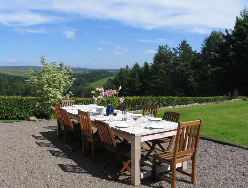 Lunch outside - a second large garden dining table has stunning views.