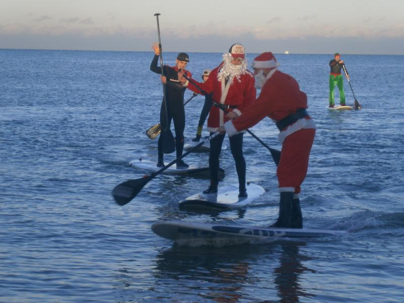 Watch the Santas surfing on Boxing Day on Joss Bay