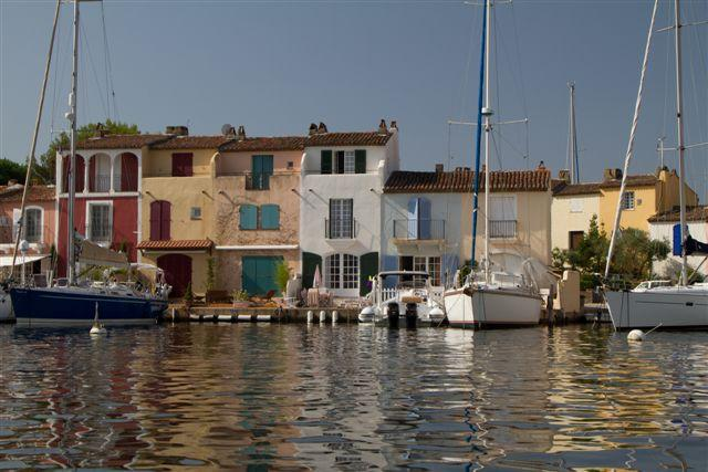 Cream house with green shutters from Port Grimaud waterway