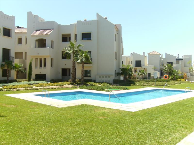 3 Bedroom 2 bathroom apartment with great access to the pool(ground floor apartment behind tree)