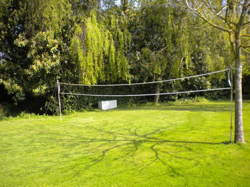 Outdoor badminton in grounds