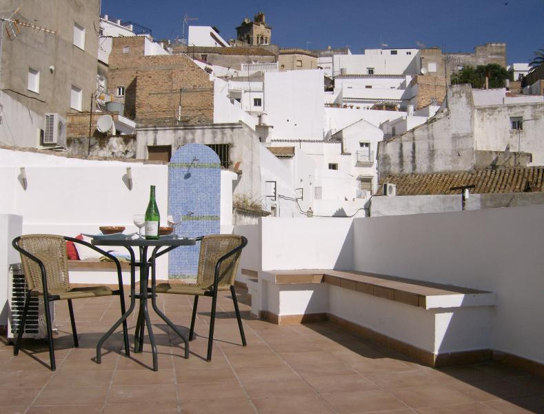 Roof terrace with seating looking towards Casco Antiguo