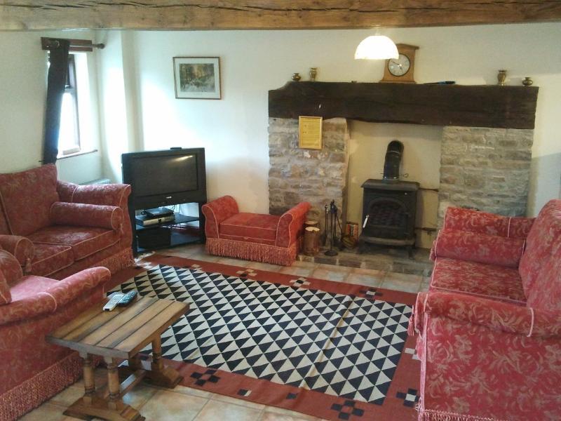 Lounge with log burner, TV/FreeSat/DVD, and sofas
