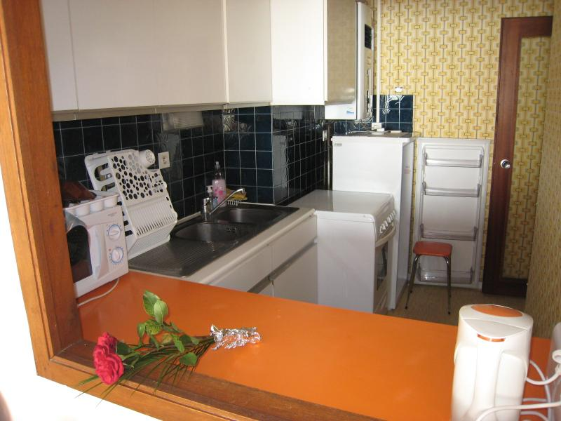 A spacious fully equiped kitchen open to the living room