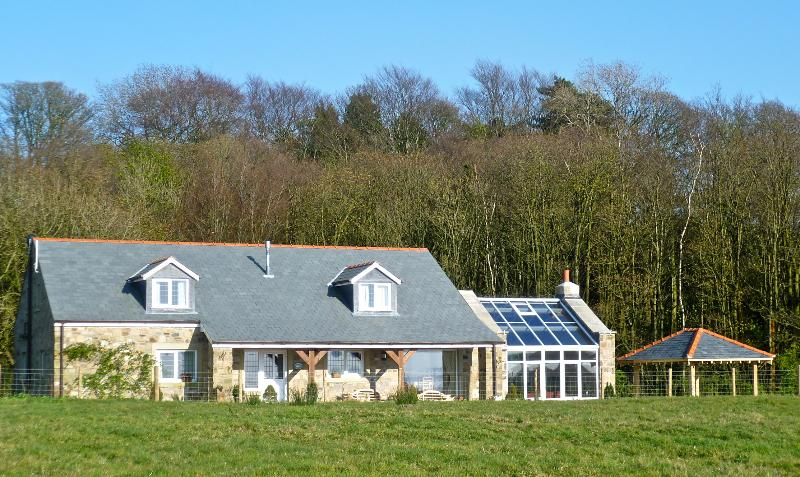 Large detached cottage,with woodland to rear, magnificent views across the countryside to the coast