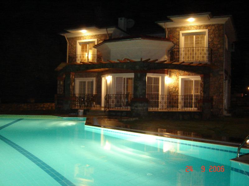 Beautiful Villa Karandjo and private swimming pool after sunset.