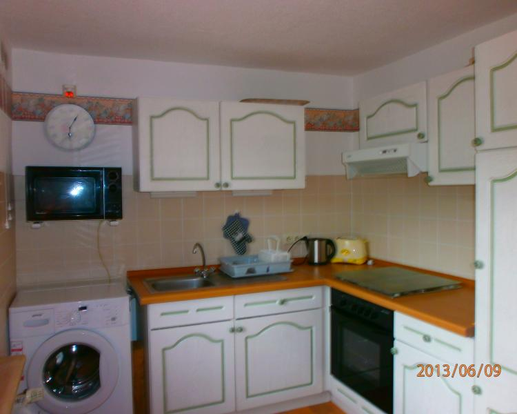 Fully catered for Kitchen with sitting area and doors to the terrace