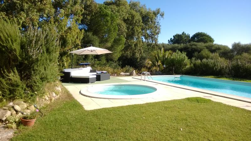 New Sofas and Umbrella by the pool