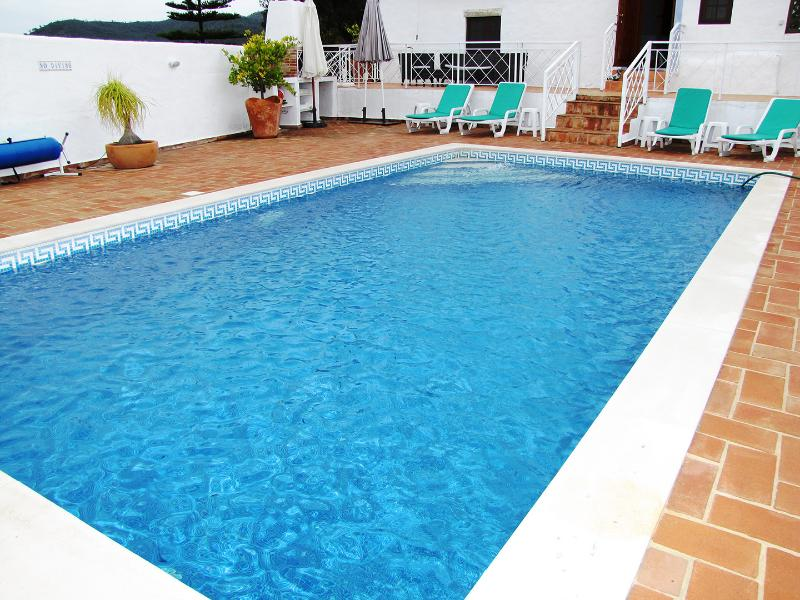 Above the pool is a top terrace with comfortable furniture fenced in enabling security for children
