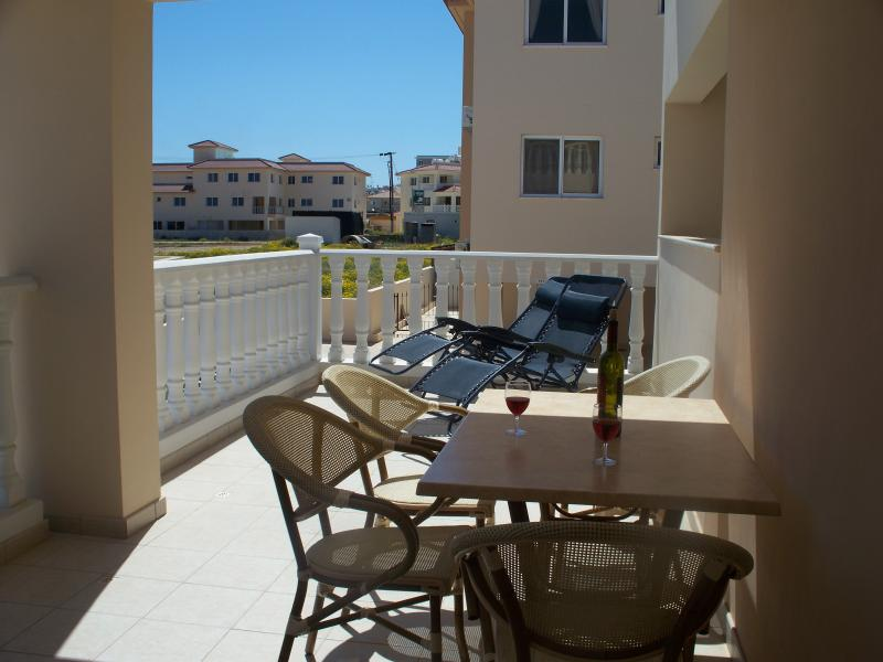 Large sunny balcony overlooking pool