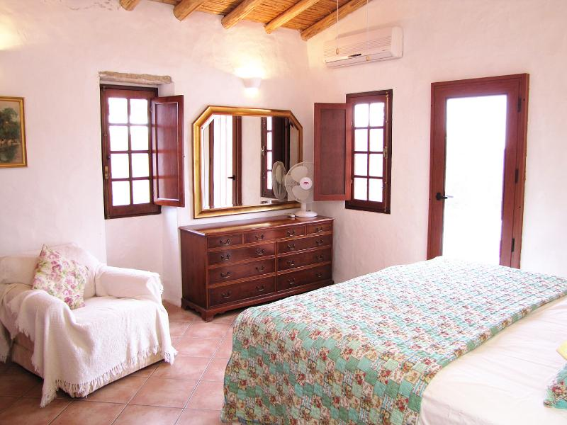 All rooms have these traditional cane ceilings.  A large wardrobe is on the left out of sight
