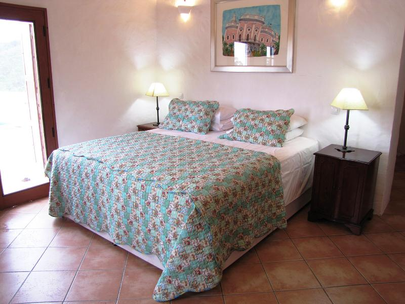 Superking (6ft) bed in the air conditioned master bedroom.  Leads onto the top terrace over the pool