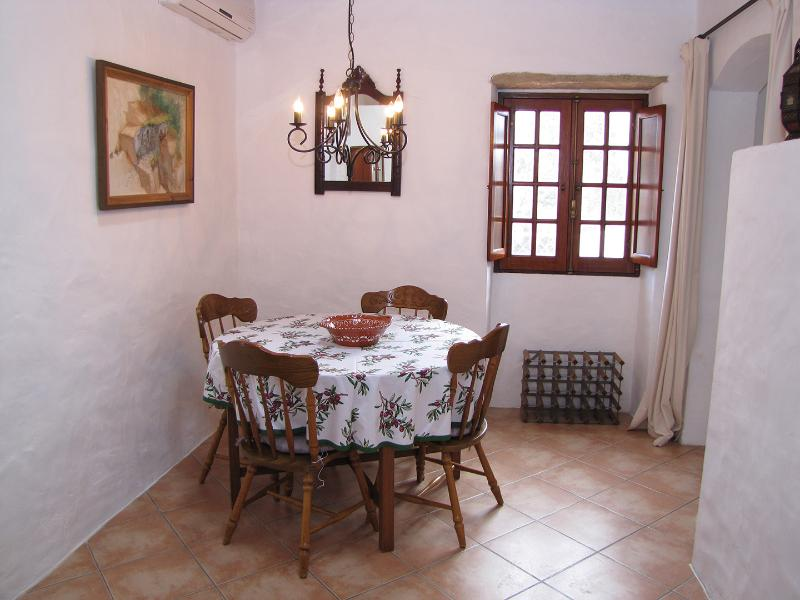 Air conditioned dining room, which in turn leads onto the living room