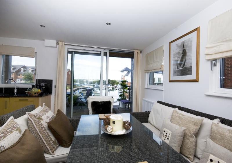 Dining overlooking the marina - fully fitted kitchen/diner leading onto open decked terrace, garden