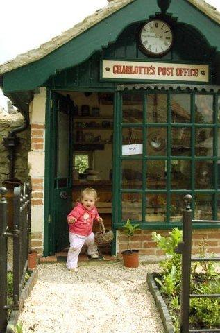 Charlotte's Post Office playhouse. A childs dream playshop. You may have trouble leaving. Have fun.