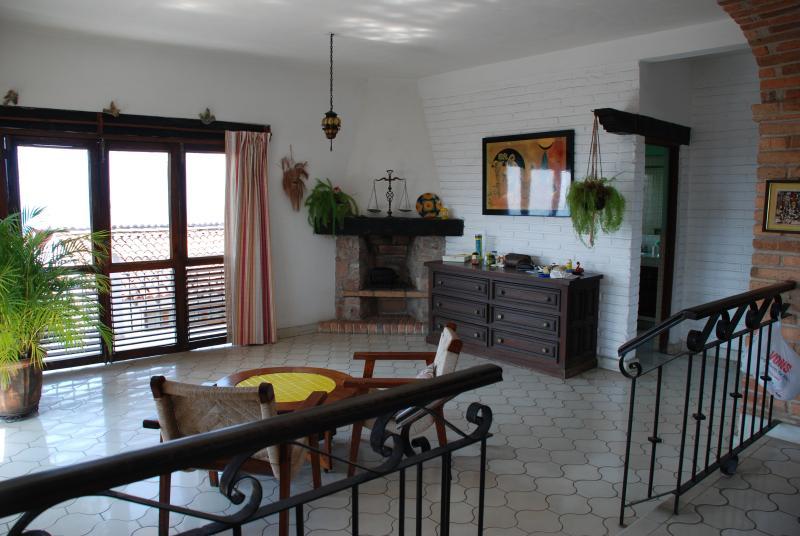 Dormitorio en Suite & balcón