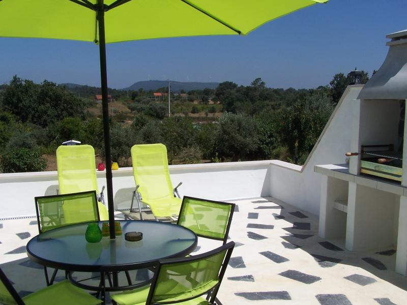 looking out over the patio, with its in-built bbq and furniture over the Portuguese countryside