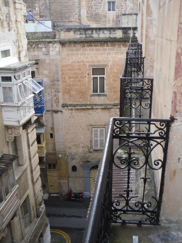 Four antique wrought iron balconies