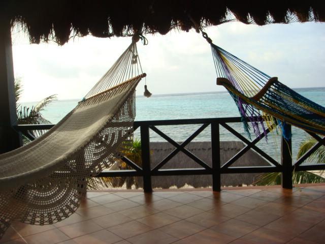 Beachview upper level terrace balcony with dinning set.