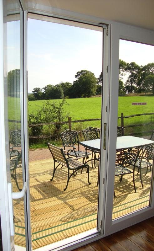 Step straight out of your lounge on to a beautiful decking area with amazing views