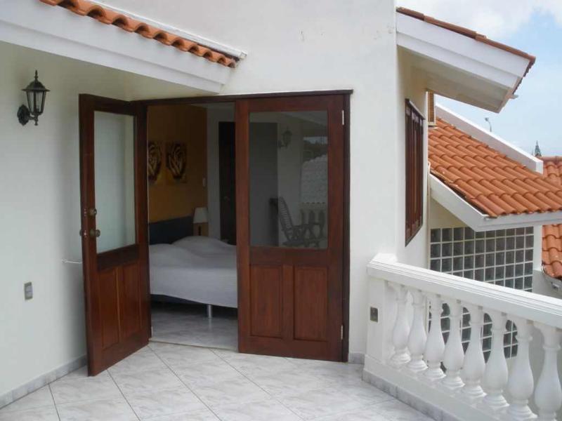 Bedroom 4 upstairs with balcony overlooking the hills of Banda Abou.