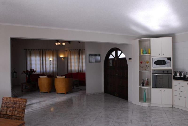 Inside the house you will find a spacious dining and sitting area.