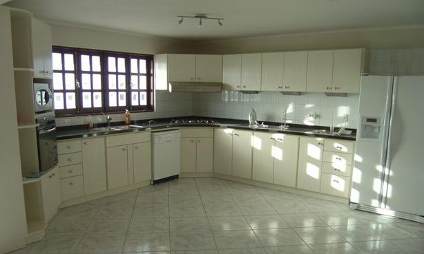 There is a large kitchen offering all contemporary appliances.