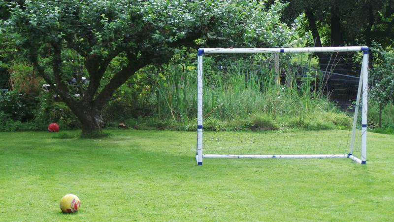 football post by apple tree. another one facing it on south facing lawn.. croquet can be played also