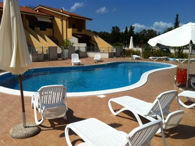 Our communal swimming pool and relaxing in the sun area