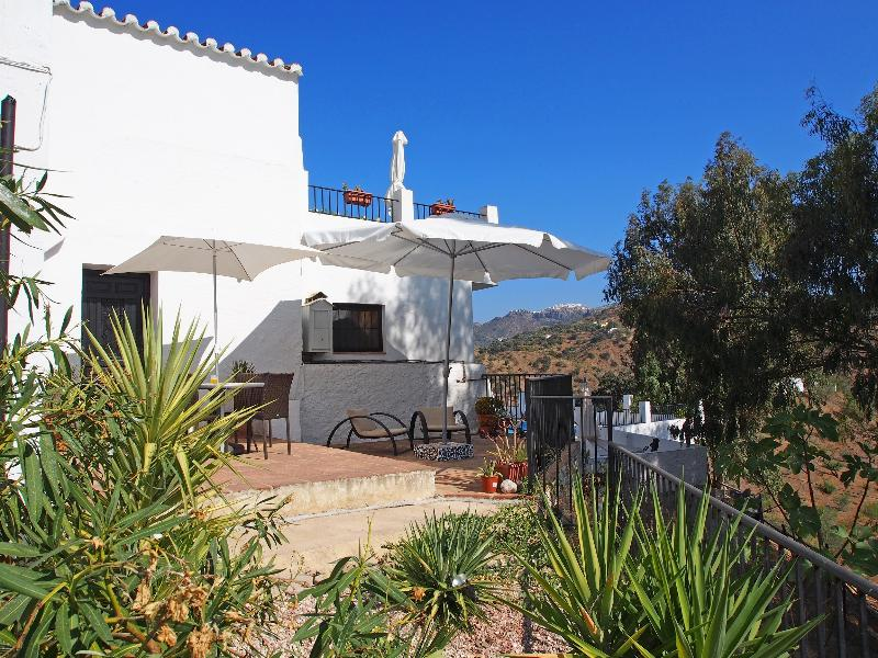 Private terrace and garden overlooking the pool area and views of Comares