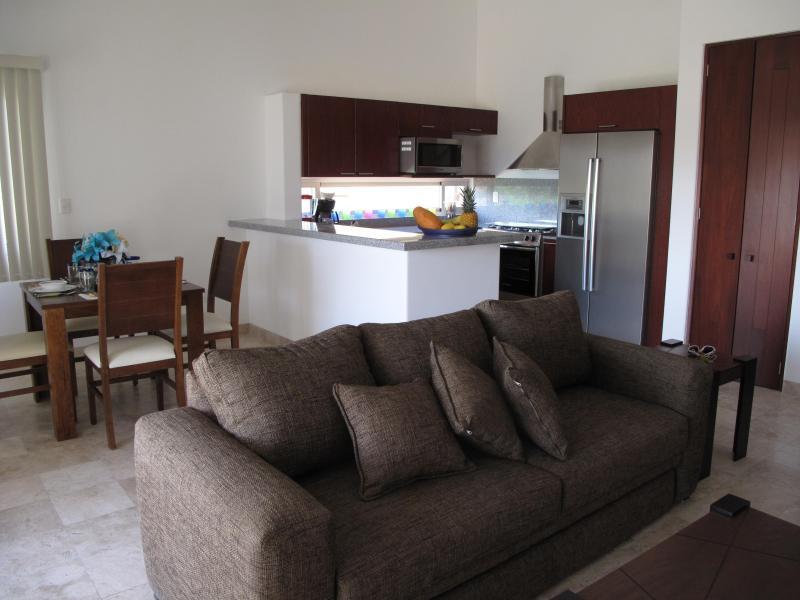 confortável sala de estar inclui sofá com bi-cama