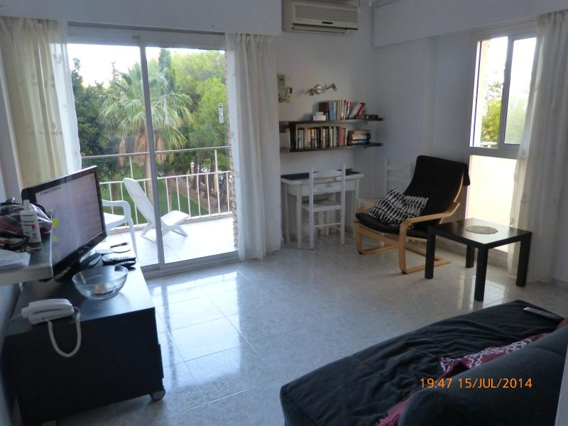 Living room with A/C, double sofa bed, large flat screen tv dvd internet English tv