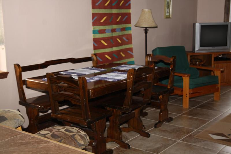 Plenty of dining space at the table, or bar!