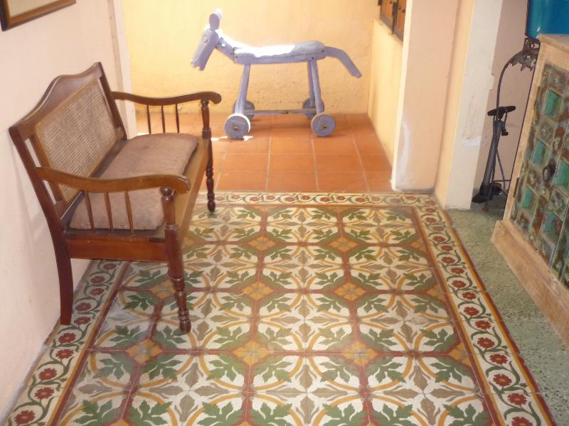 Lobby with antique floor tiles.