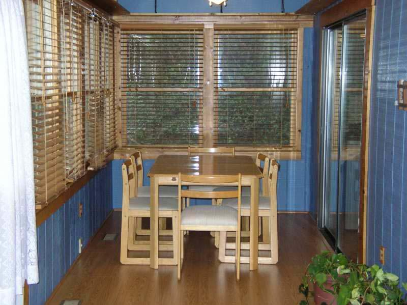 Dining table w/6 chairs in sunroom