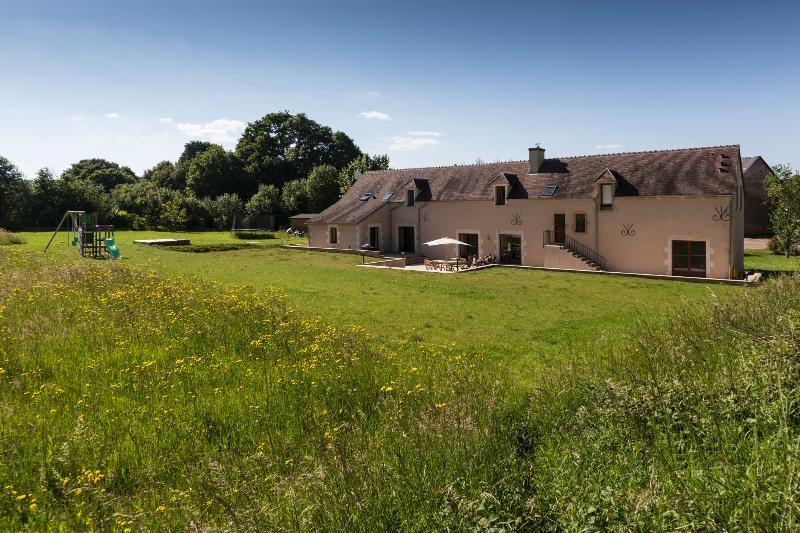 Huge converted farmhouse, with lovely terrace and garden, swing set and trampoline