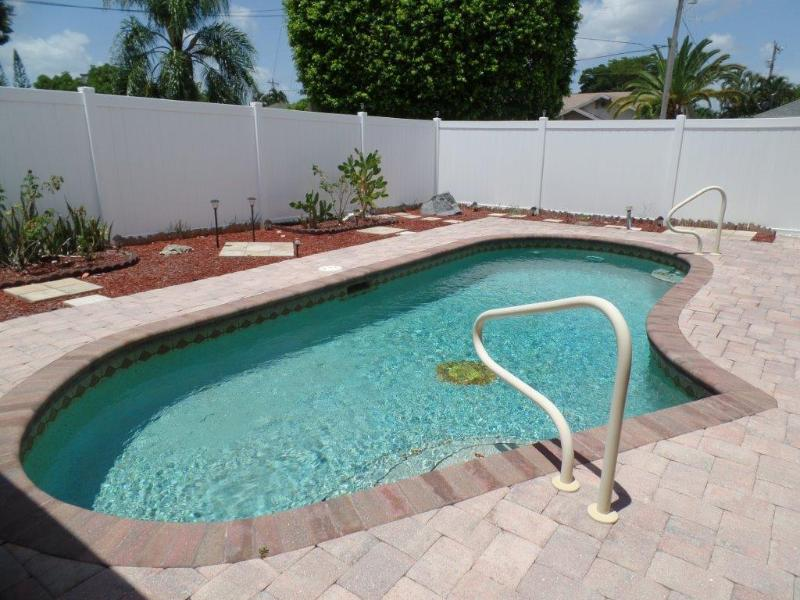 Private pool area  with 6 foot fence