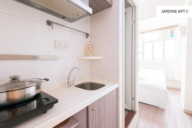 Kitchen area with stove and fridge